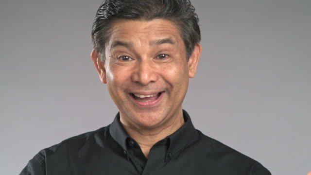 close up senior man show surprise face, isolated in grey background. asian man in black shirt. - black shirt stock videos & royalty-free footage