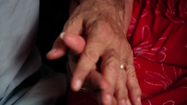 close up senior man's hand holding senior woman's hand - interlocked stock videos & royalty-free footage