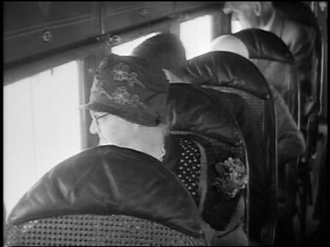 b/w 1927 close up senior woman in hat sitting in airliner looking out of windows / newsreel - flugpassagier stock-videos und b-roll-filmmaterial