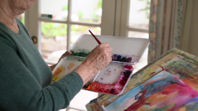 ms close up senior woman painting in her studio - hobbies stock videos & royalty-free footage