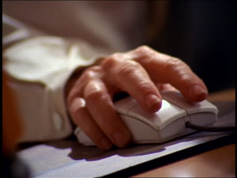 vídeos de stock, filmes e b-roll de close up senior woman's hand working computer mouse - 1990 1999