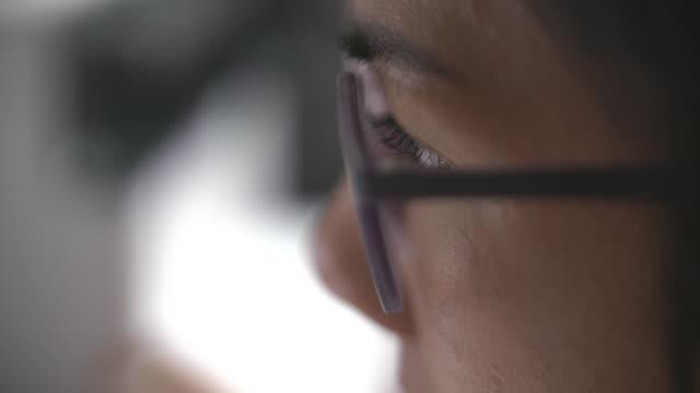 close up serious woman eye looking monitor - market trader stock videos & royalty-free footage