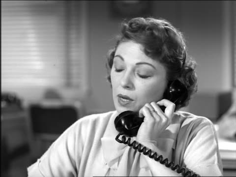 b/w 1957 close up serious woman talking on telephone - 1950 stock videos & royalty-free footage