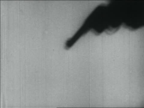 b/w 1934 close up shadow of man's hand pointing pistol - handgun stock videos and b-roll footage
