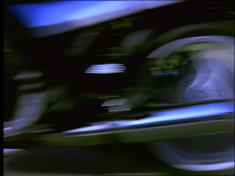 close up shaky cam tracking shot of motorcyclist's foot shifting gears