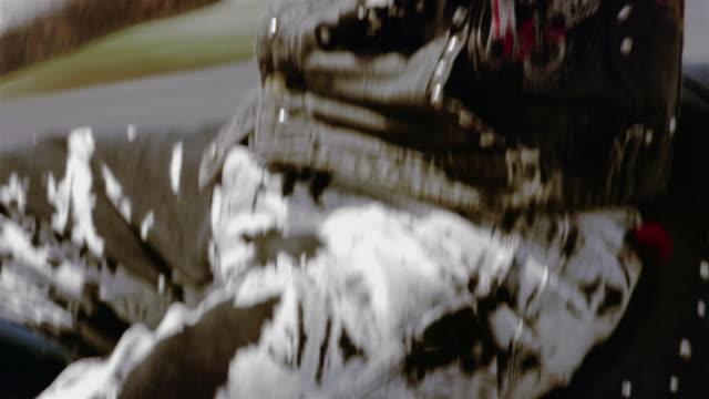 close up shaky motorcycle tire / pan biker riding motorcycle / miami, florida - sideburn stock videos and b-roll footage