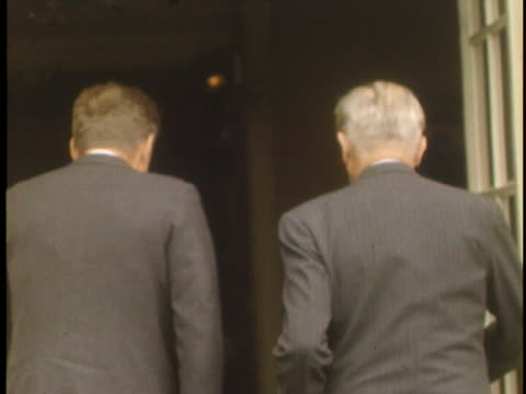 close up shaky off stix shot of president john f kennedy and prime minister harold macmillan standing next to each other kennedy is camera left and... - shaky stock videos & royalty-free footage