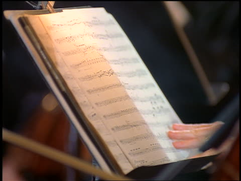 close up sheet music / cellist in foreground - cellist stock videos & royalty-free footage