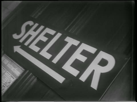 "close up ""shelter"" sign by air raid shelter in nyc / newsreel - cold war stock videos & royalty-free footage"