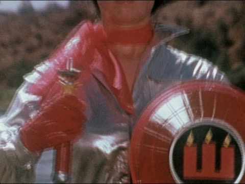 vidéos et rushes de 1978 close up shield with crest of candles / zoom out medium shot female superhero waving unlit torch or candle holder - 1978
