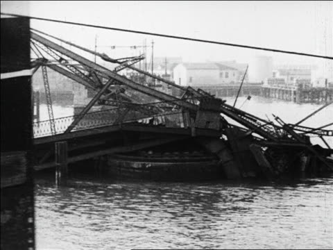 b/w 1926 close up ship passing camera with collapsed bridge in water in background / san francisco / slate - 1926 stock videos & royalty-free footage