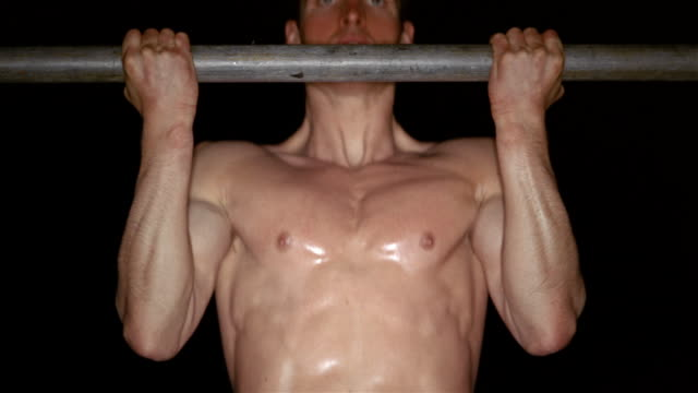 close up shirtless muscular man doing chin ups on bar - handsome people stock videos & royalty-free footage