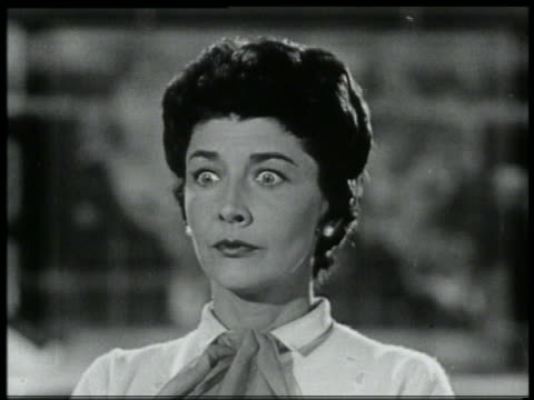 vidéos et rushes de b/w 1959 close up shocked woman turning head - surprise