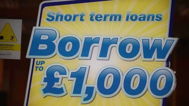 close up short term loan advert payday loan stores are to face tougher regulations after moves proposed by the financial conduct authority call on... - pawnbroker stock videos & royalty-free footage