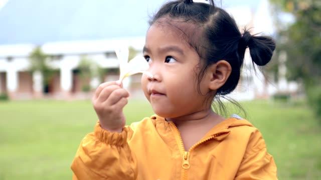 close up shot Asian child-girl hold white flower