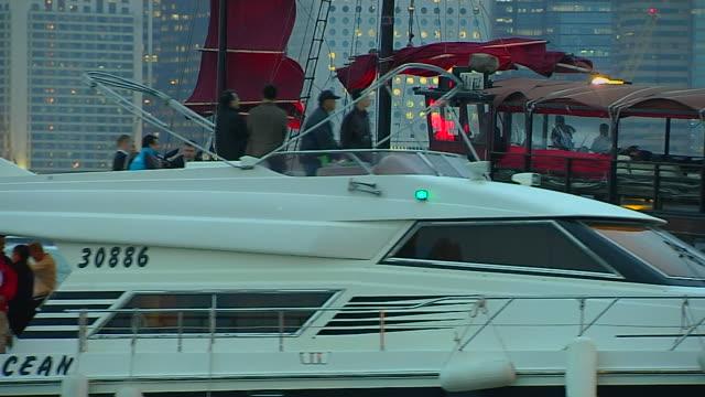 close up shot ferry passing aberdeen harbour hong kong kwangtung china - aberdeen hong kong stock videos & royalty-free footage