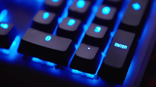 close up shot finger is pressing enter key on keyboard with blue light. - enter key stock videos & royalty-free footage