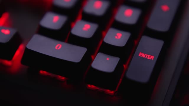 close up shot finger is pressing enter key on keyboard with red led light. - enter key stock videos & royalty-free footage