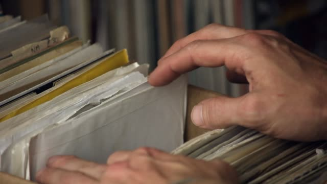 close up shot - flicking through 7 inch singles - collection stock videos & royalty-free footage