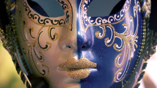 close up shot of a carnival mask blowing in the wind. - fasching stock-videos und b-roll-filmmaterial