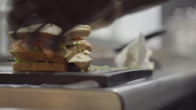 close up shot of a club sandwich being cut into halves - sandwich stock videos & royalty-free footage