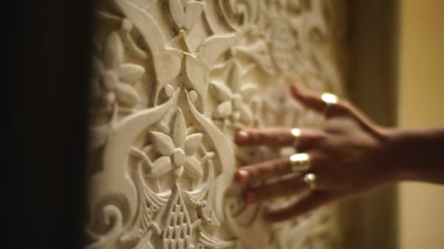 close up shot of a hand on an ornate wall - touching stock videos & royalty-free footage