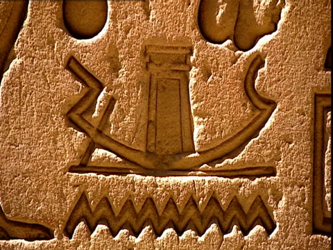close up shot of a highprow boat with a shrine in the centre and wavy lines beneath representing water the relief is carved on the back wall of the... - cleopatra stock videos & royalty-free footage
