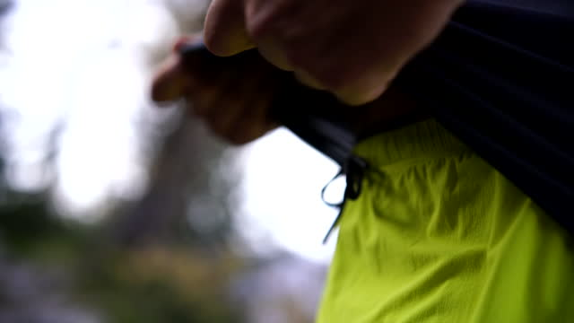 close up shot of a man tying drawstrings on yellow shorts - running shorts stock videos & royalty-free footage