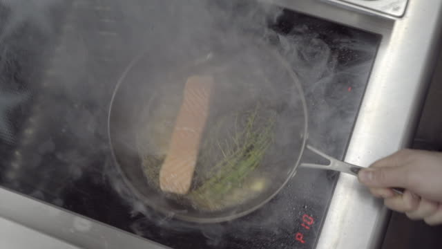 close up shot of a salmon filet being pan seared - cooking pan stock videos & royalty-free footage