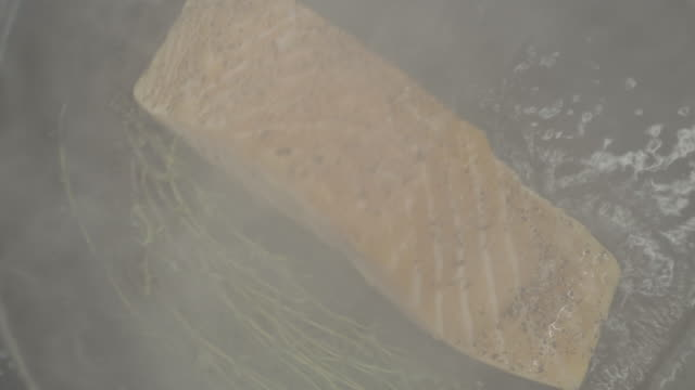 close up shot of a salmon filet being pan seared - filleted stock videos & royalty-free footage
