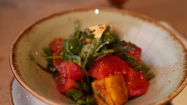 close up shot of a small tomato salad - tomato salad stock videos & royalty-free footage