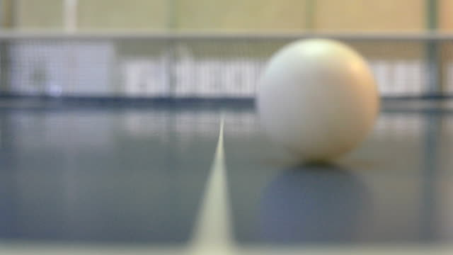 close up shot of a table tennis ball rolling towards the camera - table tennis stock videos & royalty-free footage