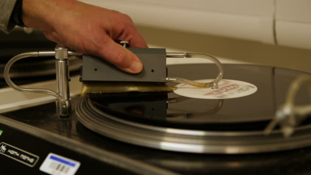Close up shot of a vinyl record being cleaned on a vinyl washing machine