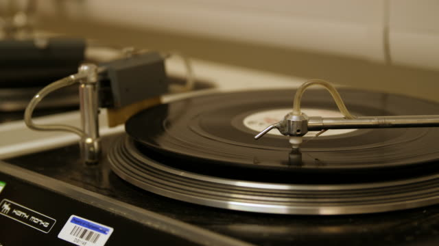 Close up shot of a vinyl record being dried with an air blower on a vinyl washing machine