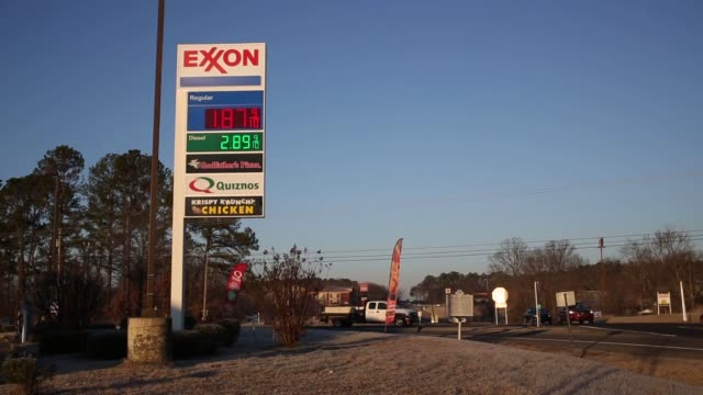 close up shot of an exxon sign above an exxon gas station in portland tennessee motorists fill up their vehicles at an exxon gas station in portland... - exxon stock videos & royalty-free footage