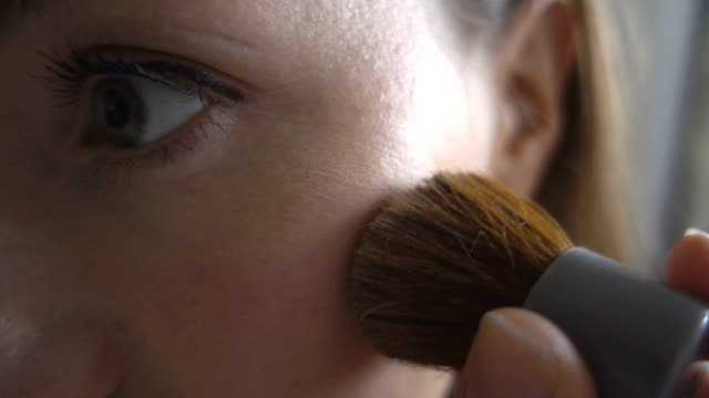 slomo - close up shot of applying facial powder using special brush - blusher make up stock videos and b-roll footage
