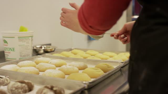 Close up shot of baker decorating cookies with powdered sugar / Salt Lake City, Utah, United States