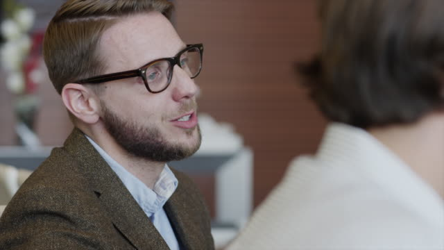 close up shot of bearded businessman talking to co-workers / provo, utah, united states,  - persuasion stock videos and b-roll footage
