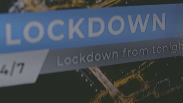close up shot of breaking news on tv due to 24/7 lockdown - news event stock videos & royalty-free footage