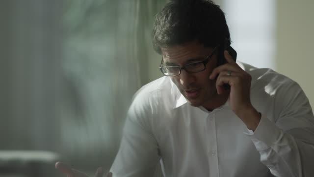 close up shot of businessman talking on cell phone / provo, utah, united states,  - 説得点の映像素材/bロール