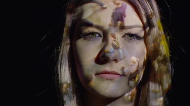 Close up shot of crowd projections on woman's face / Cedar Hills, Utah, United States