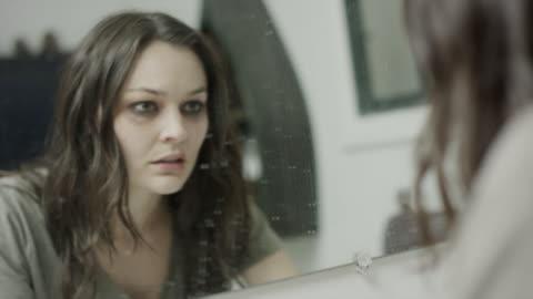 vídeos y material grabado en eventos de stock de close up shot of domestic violence victim staring into mirror / springville, utah, united states - staring