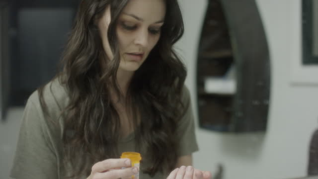 vidéos et rushes de close up shot of domestic violence victim taking pills in mirror / springville, utah, united states - springville utah