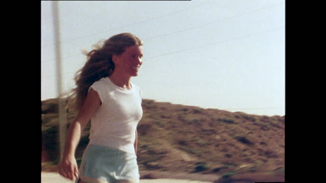 close up shot of ellen o'neal, professional skateboarder, skateboarding down a hill; 1978. - young women stock videos & royalty-free footage