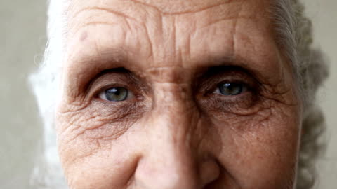 dolly close up shot of eyes of a senior woman - blinking stock videos & royalty-free footage