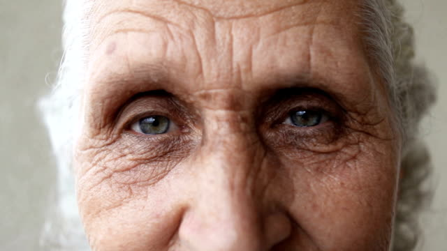 DOLLY Close up shot of eyes of a senior woman