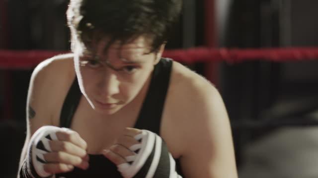 close up shot of female boxer practicing in boxing ring / lehi, utah, united states - lehi stock videos & royalty-free footage