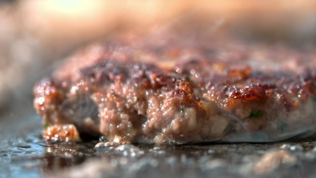 slo mo close up shot of frying a burger - hamburger stock videos & royalty-free footage