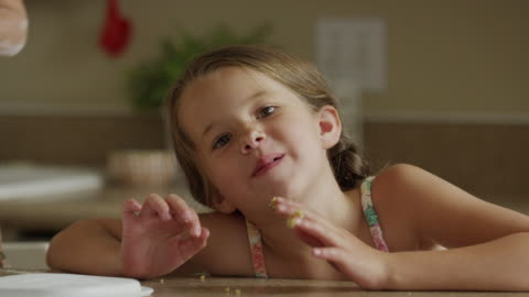 close up shot of girl licking cookie dough from fingers / orem, utah, united states - licking stock videos & royalty-free footage