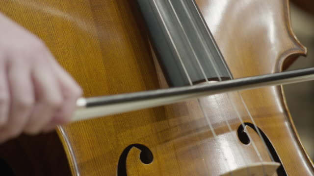 vidéos et rushes de close up shot of girl playing cello in orchestra / salt lake city, utah, united states - instrument de musique
